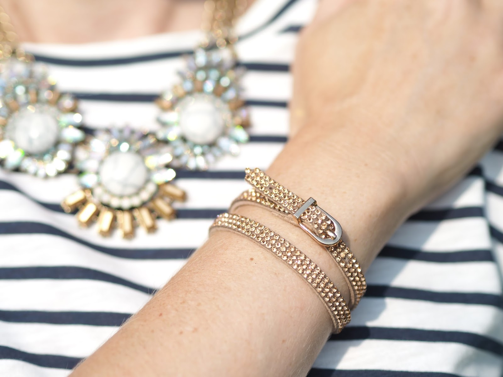 Striped cocoon dress, statement necklace and rose gold wrap bracelet