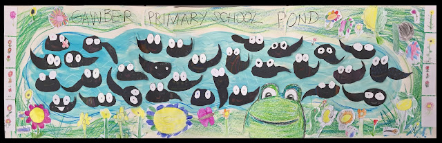 picture shows pond freize drawn by school children for Bug Belly book
