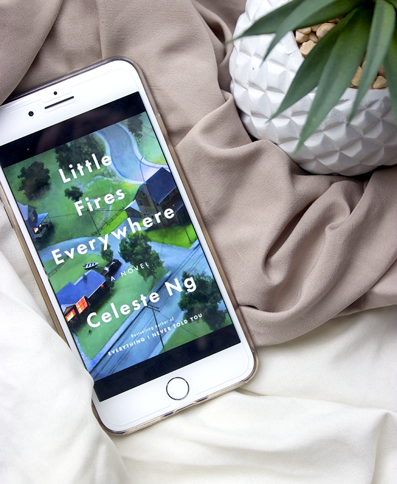 little fires everywhere by celeste ng review, kindle version flatlay with plant and bedding