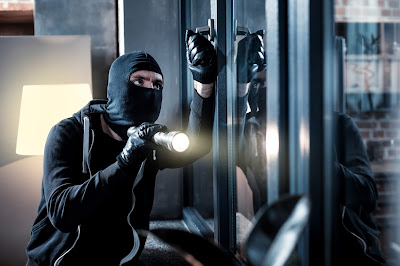 Loss Prevention with self storage from Boylin's: thief breaking into building