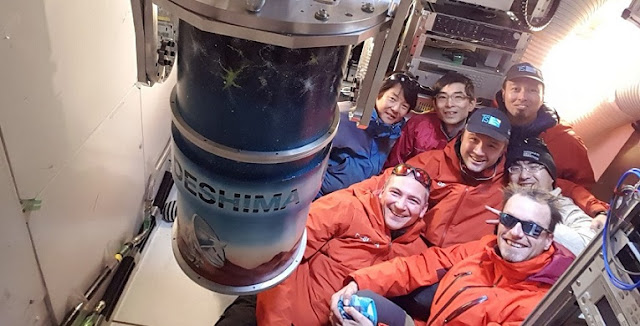 The proud team after mounting the DESHIMA instrument on the ASTE telescope of the National Astronomical Observatory of Japan (NAOJ) in Chile's Atacama Desert. From left to right, (back row): Toshihiko Kobiki, Tai Oshima (NAOJ), Kenichi Karatsu (TUdelft); (front row): David Thoen, Akira Endo, Robert Huiting (TUdelft), Tatsuya Takekoshi (The University of Electro-Communications, Japan)  Photograph credit: Robert Huiting (SRON)