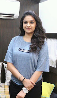 Keerthy Suresh in Blue T-Shirt with Cute and Lovely Smile with a Lucky Fan