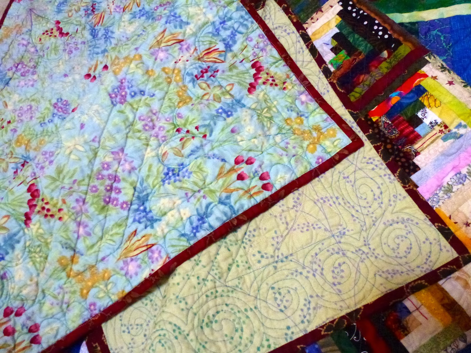 Straight-line, feather and spiral designs were used for the quilting.