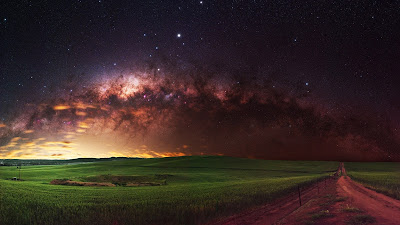 Galaxy HD wallpaper over green field