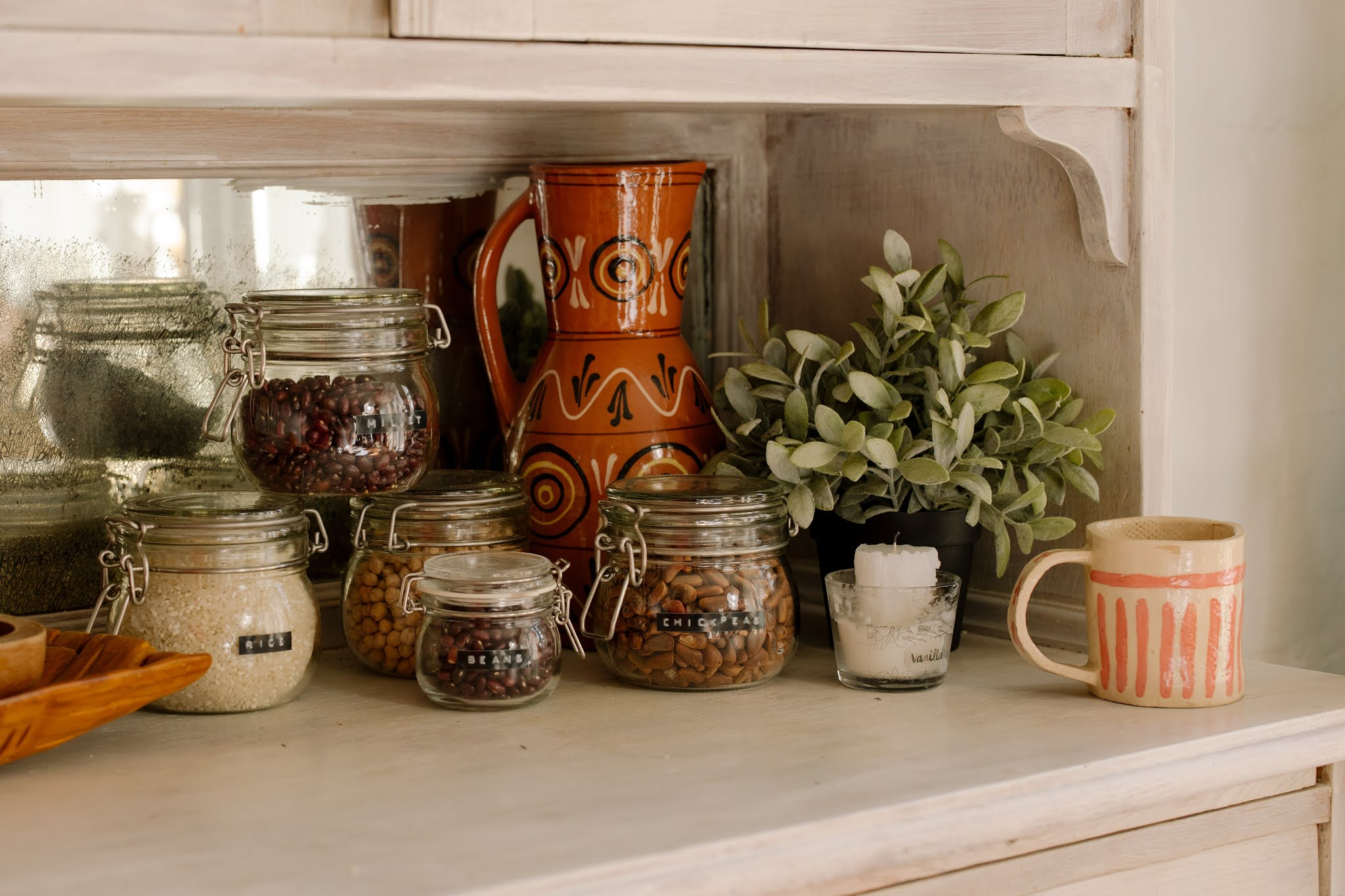 Brown Ceramic Vases on White Table by CottonBro free stock image on Pexel