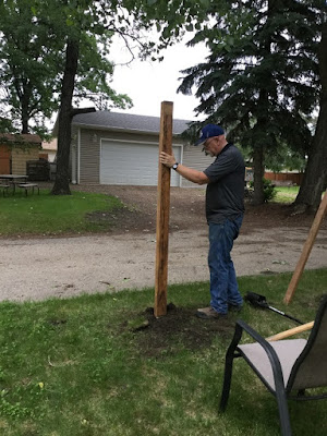 Putting in the first fence post