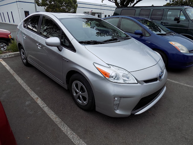 2012 Prius with delaminating or peeling paint on the front bumper after repair at Almost Everything Auto Body.