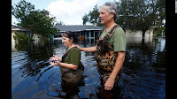 Kelly McClenthen and her boyfriend, Daniel Harrison, walk through floodwaters in Bonita Springs, Florida, on Monday, September 11. Hurricane Irma was downgraded to a tropical storm Monday, but its heavy winds and rain still pose a threat as it plows into Georgia and other parts of the Deep South. (Credit: CNN) Click to Enlarge.