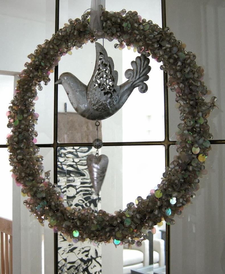 filigree bird with wreath