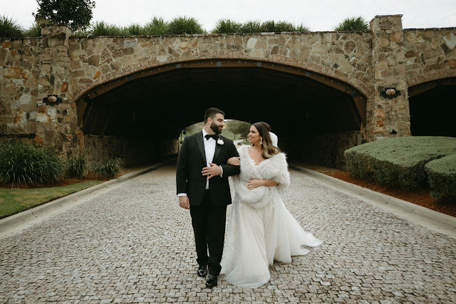 groom and bride in fur coat