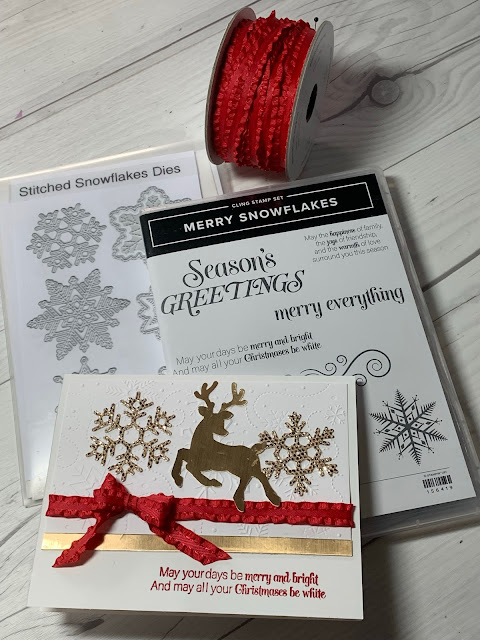 Craft tools used to create this snowflake and deer-themed greeting card