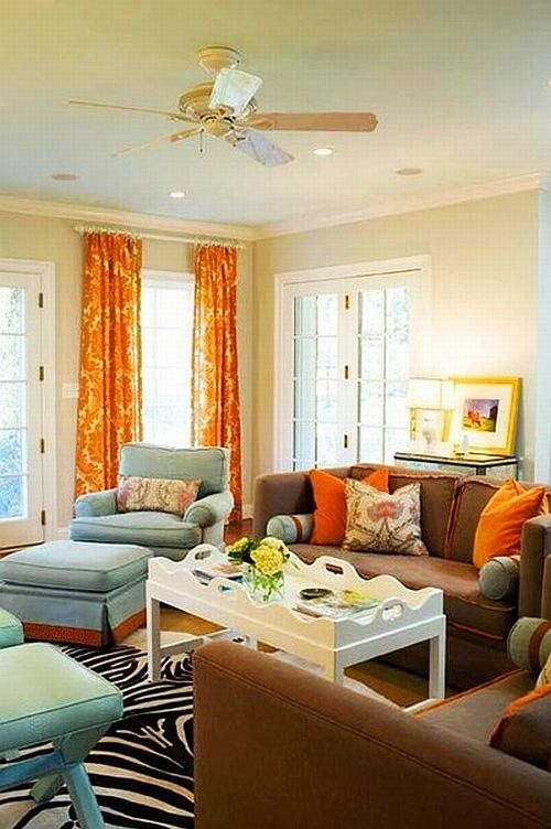 Beautiful Classic Living Room With Brown Couches And Orange Curtains