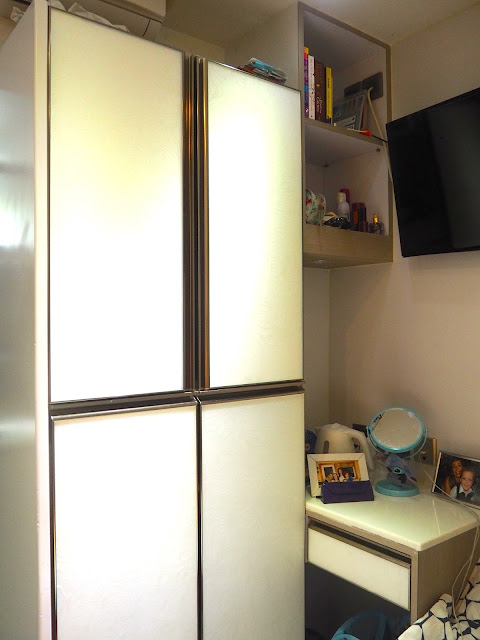 Wardrobe and table area of my studio apartment in Sham Shui Po, Kowloon, Hong Kong