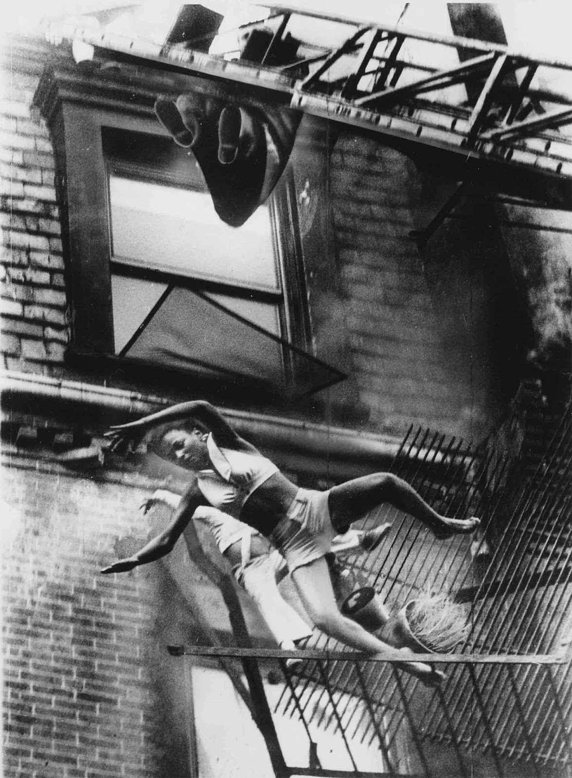A Mother And Her Daughter Falling From A Fire Escape 1975