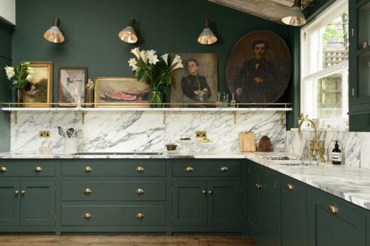Dark green kitchen cabinets and dramatic white marble on Hello Lovely