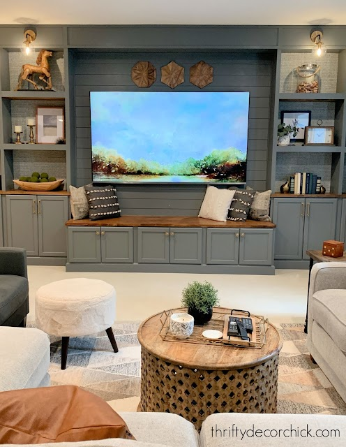 gray TV bookcase wall with bench