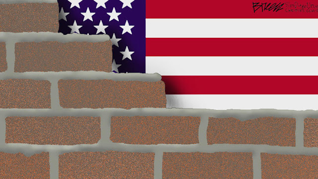 Image of US Flag being hidden behing Donald Trump's wall.