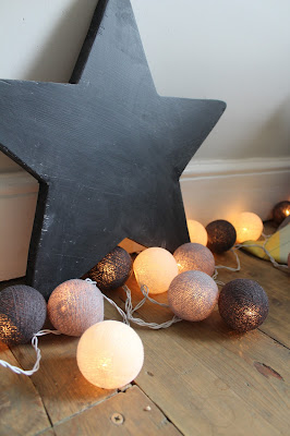 grey and white cotton ball fairy lights