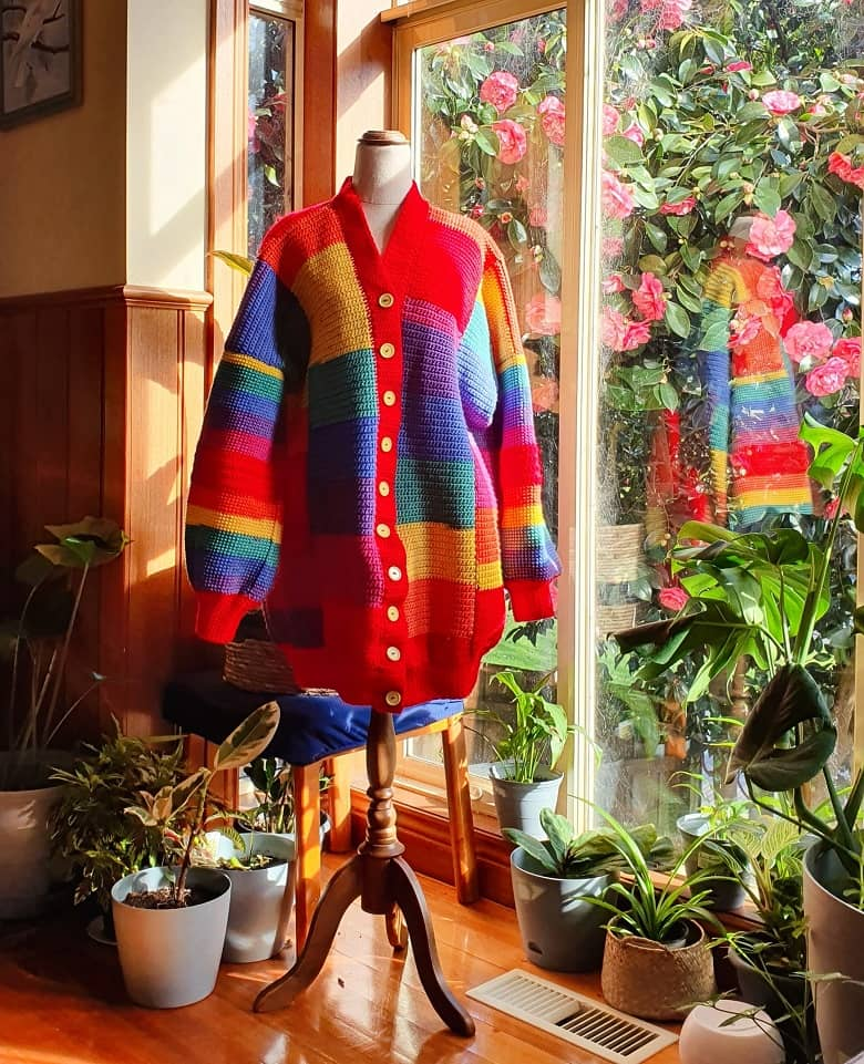 a picture of a mannequin wearing a rainbow jumper