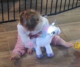 Rosie with her unicorn