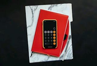 a notebook, pen, and calculator