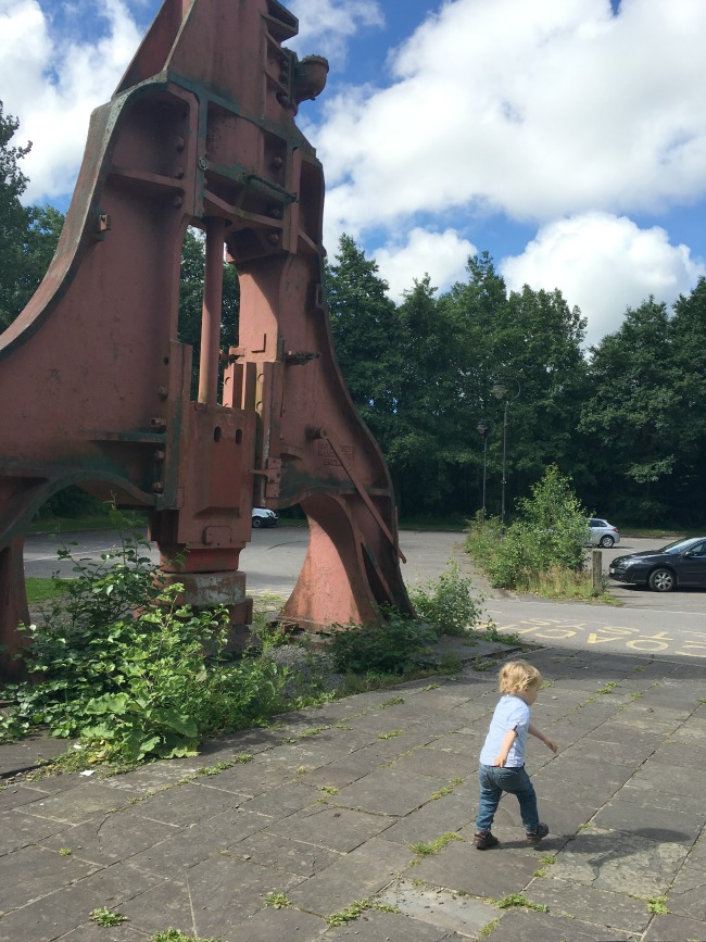 toddler-walking-away-blaenavon-ironworks-big-metal-press