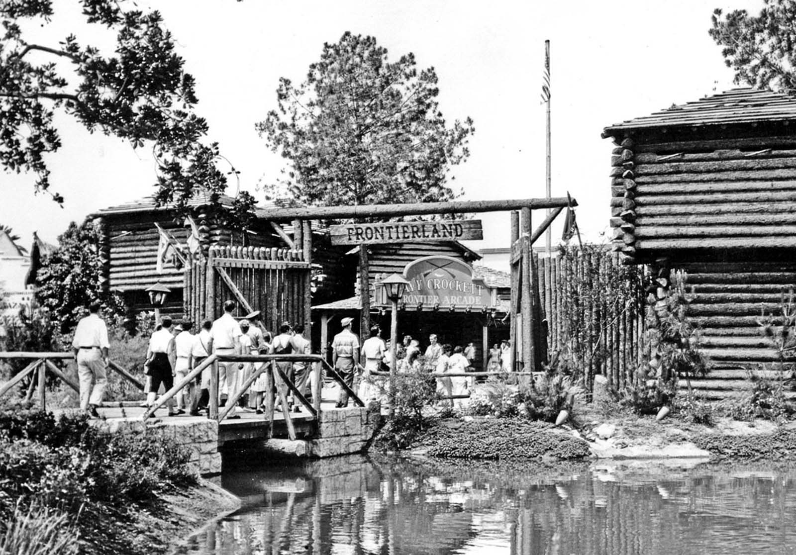 Tourists enter Frontierland, a re-creation of the Old West, in Disneyland, ca. 1955.