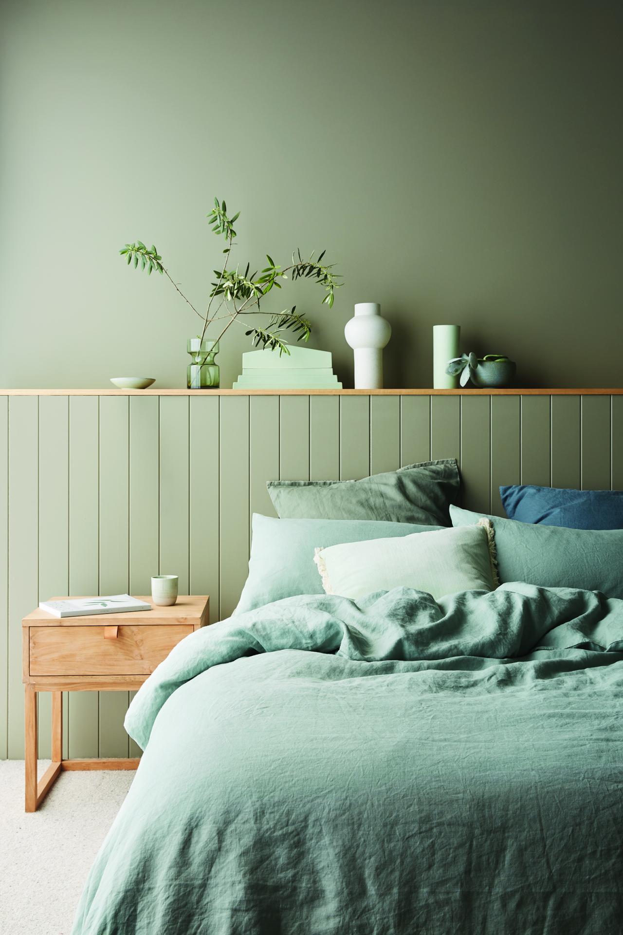 chambre à coucher verte et minimaliste