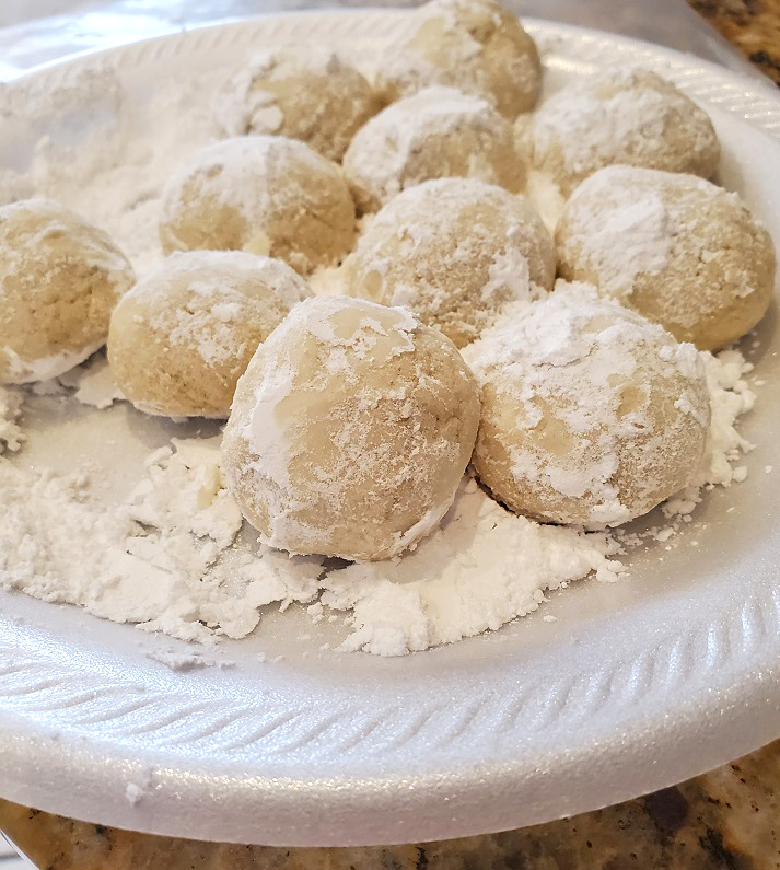 these are cookies rolled into powdered sugar in a ball shape