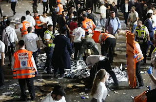 Israeli rescue forces and police near the scene after a stampede killed dozens during the celebrations of the Jewish holiday of Lag Baomer on Mt. Meron on April 30, 2021. (photo credit: DAVID COHEN/FLASH 90)