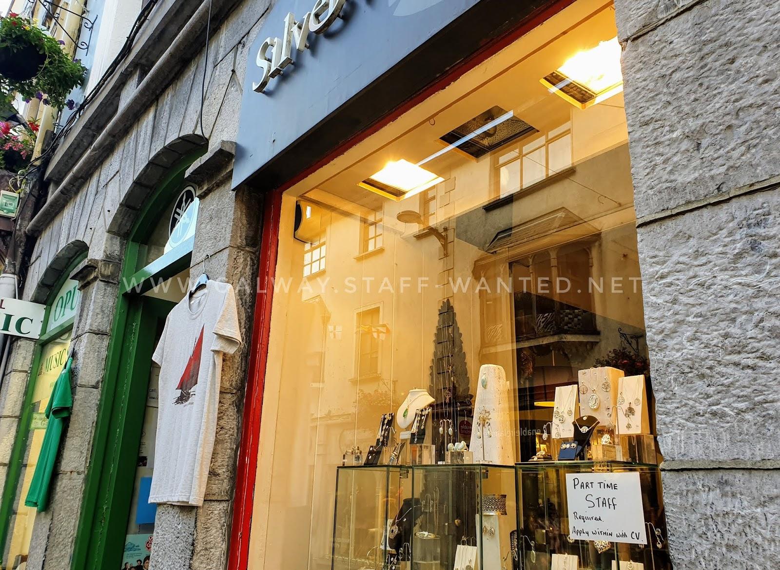 Job advertising in jewellery shop window.    Next door Galway hooker tee shirts from Opus Two music shop