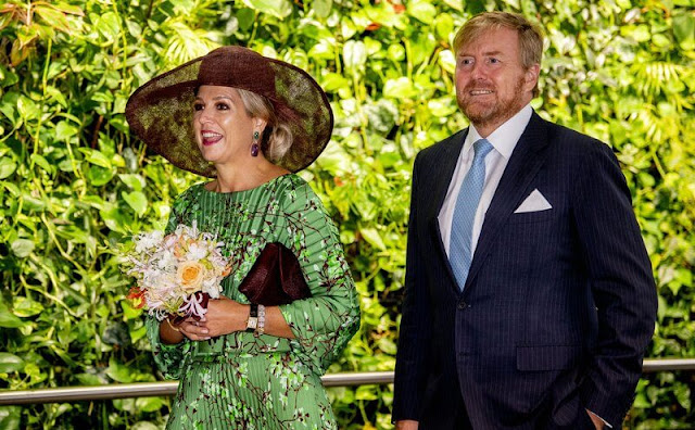 Queen Maxima wore a new floral printed pleated twill blouse and floral printed pleated twill skirt from Natan