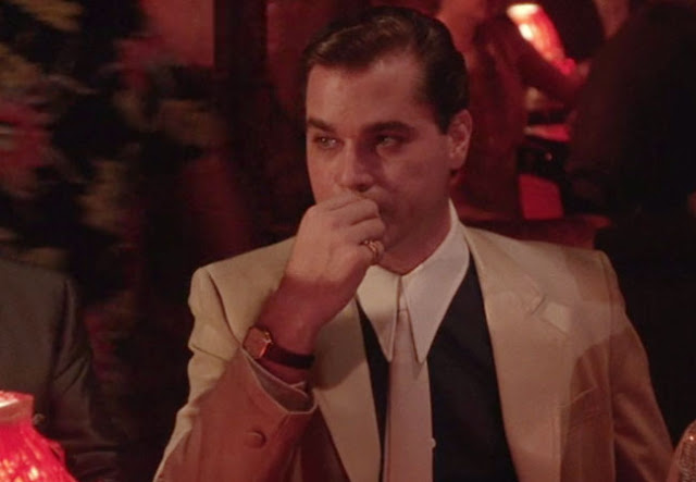 Esquire, in an article on clothing the Goodfellas wore, called the shirt, simply, The Point Collar Shirt.