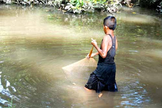 Cambodian Boy Fishing Siem Reap Cambodia