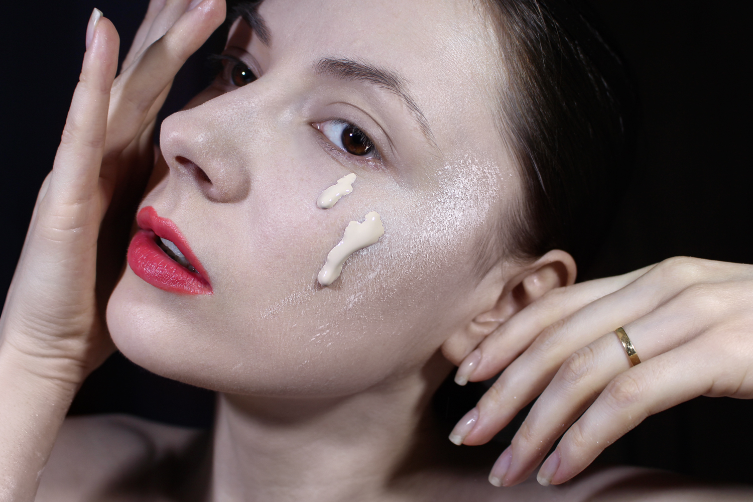 a close-up portrait of a woman with a makeup powder on her face