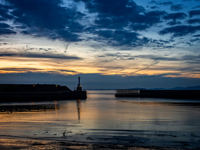 Photo of the view across Maryport basin to the Solway Firth just after sunset