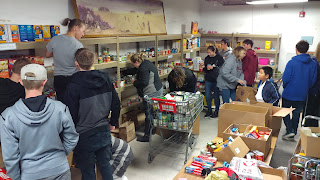 Taekwondo students helping at local food bank