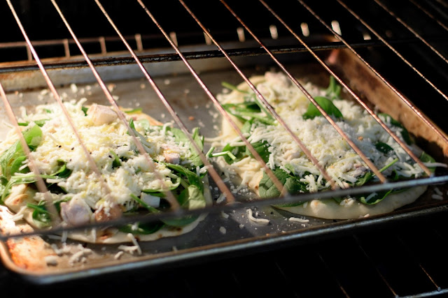 The Chicken and Spinach Naan Bread Pizzas in the oven.