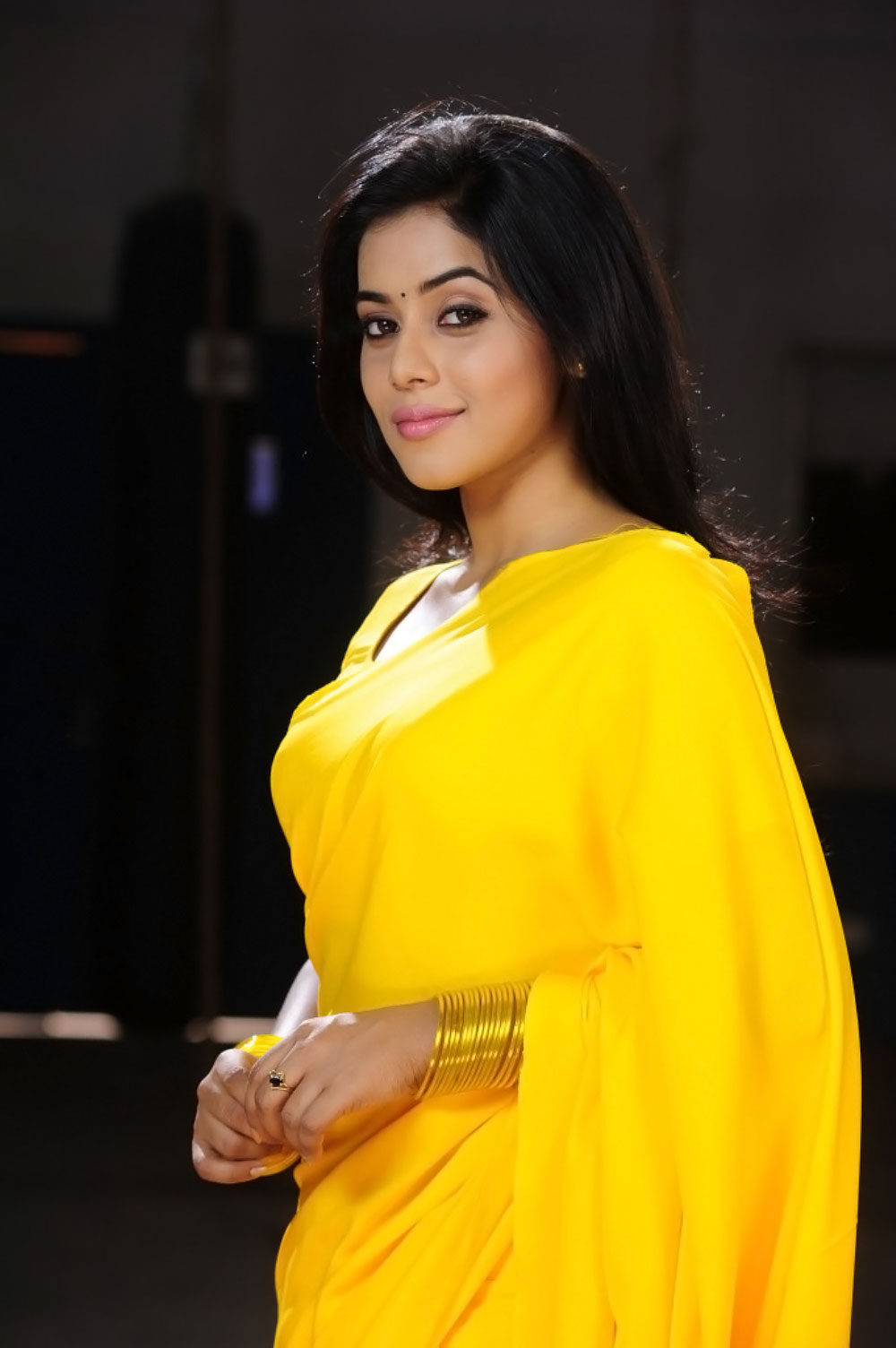 Poorna Hot Looking Photos In Yellow Saree