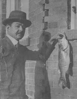 A photograph of Wilder Montgomery 1906 holding a large fish that he had caught