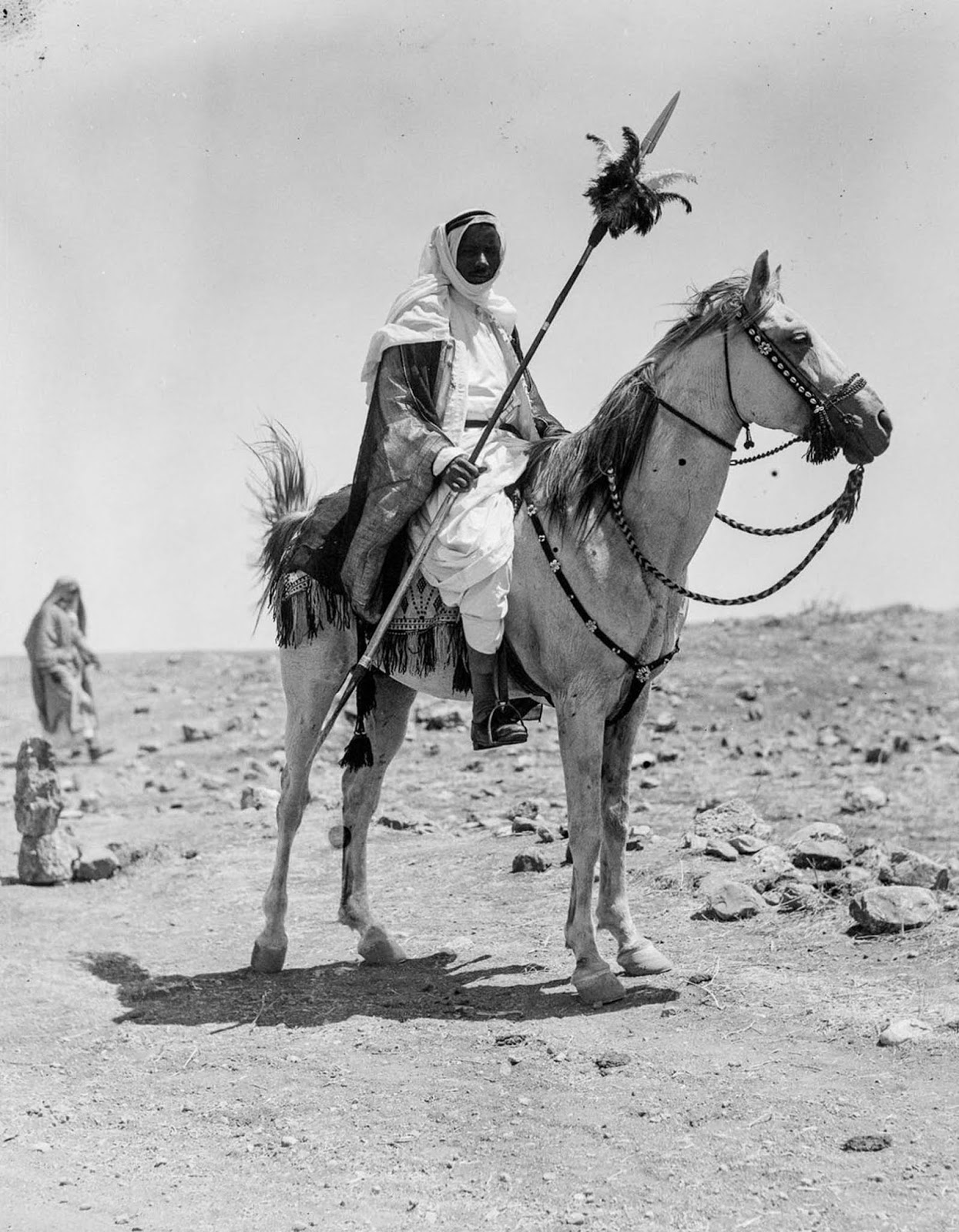 A Bedouin man riding his horse.