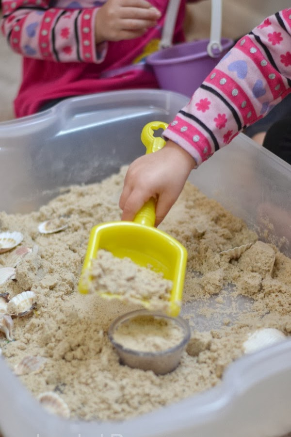 STICKY SAND: a less messy alternative to traditional play sand, and you can make it at home! #homemadeplaysand #sandboxideas #stickysand #stickysandrecipe #stickysandart #stickysanddiy #stickysanddough #sandrecipe #sandrecipesforkids #growingajeweledrose