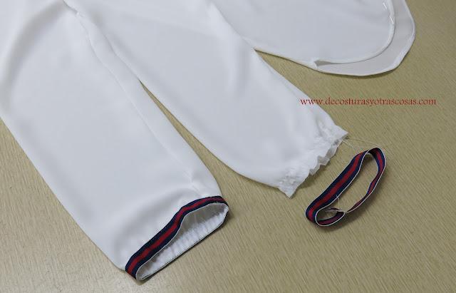 como coser cinta grosgrain en una manga con puño