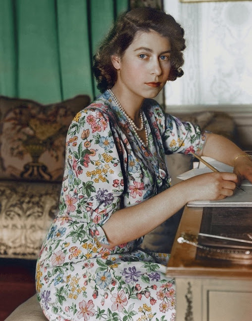 Britain's Princess Elizabeth (Queen Elizabeth II) pictured seated at a desk reading a book at Windsor Castle, Berkshire in Britain