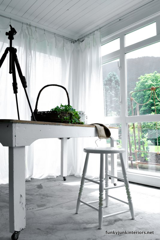 white room ceiling farm table stool photo studio