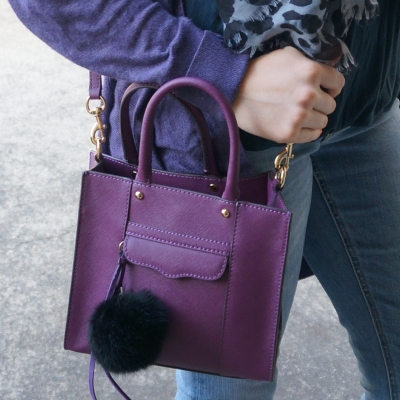 Faux fur pom pom charm on Rebecca Minkoff mini MAB tote in plum | Away From The Blue
