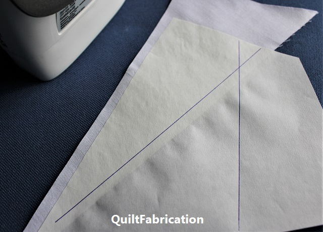 over-sized fabric pieces with added seam allowances for paper piecing
