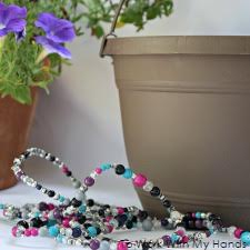 Decorating a flower pot with beads