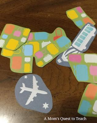 scrapbook paper images of trains, planes, suitcases