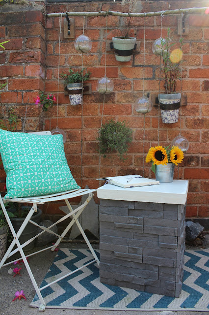 diy table with tiled base and concrete top